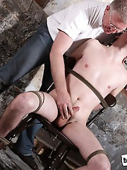 Ties to a chair with rope and blindfolded, Jonny Parker really is at Sebastian's mercy in this video. His uncut cock exposed, it's not long