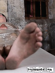 Blindfolded and wrapped tight in cling film like a modern-day twink mummy, Aaron Aurora is in no position to protest an older man playing with his exp